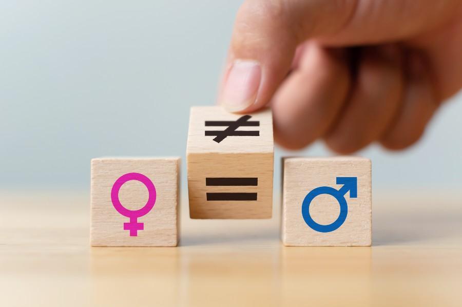Simbolo femminile e simbolo maschile, divisi dal segno uguale al centro.