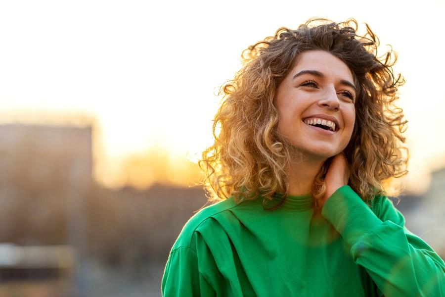 PMA - procreazione medicalmente assistita: nell'immagine una ragazza sorridente