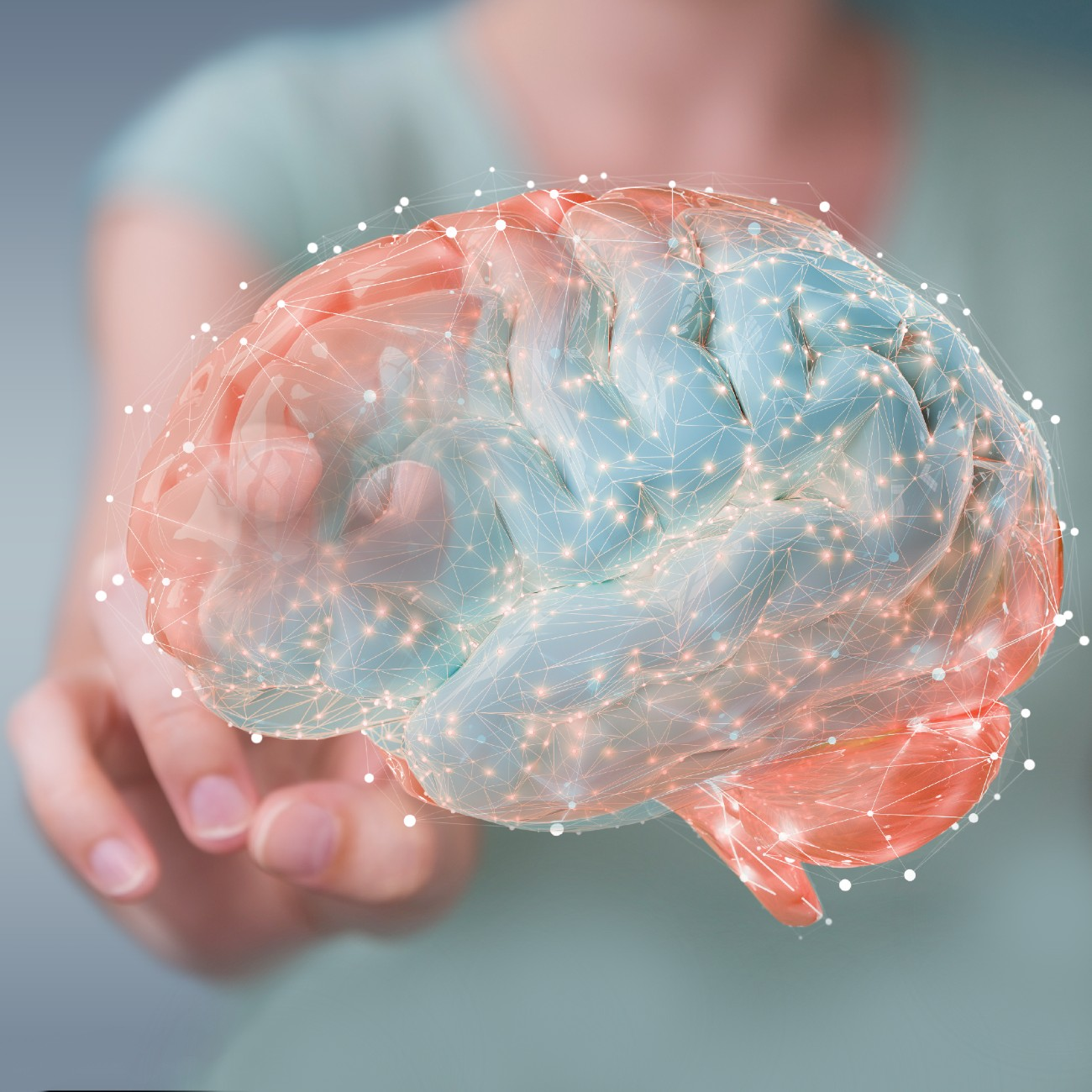 infertilità e sostegno psicologico durante il percorso di PMA: nell'immagine una donna tocca un ologramma di cervello umano